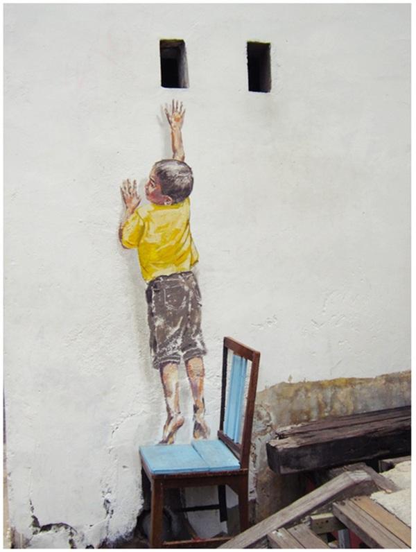 艺术家Ernest Zacharevic的错觉街头艺术
