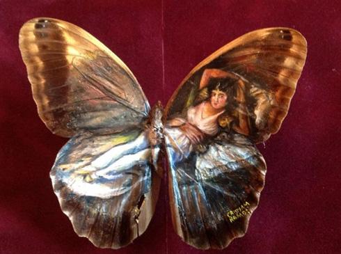 牛人蝴蝶翅膀上作画
